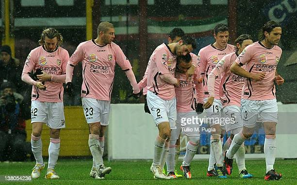 Fabrizio Miccoli of Palermo celebrates with teammates after scoring his team's second goal during the Serie A match between FC Internazionale Milano...