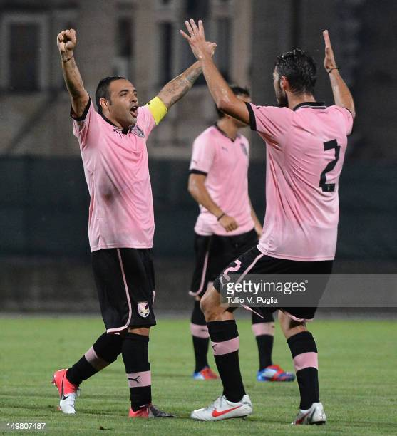Fabrizio Miccoli of Palermo celebrates with teammates after scoring the opening goal during the preseason friendly match between US Citta di Palermo...