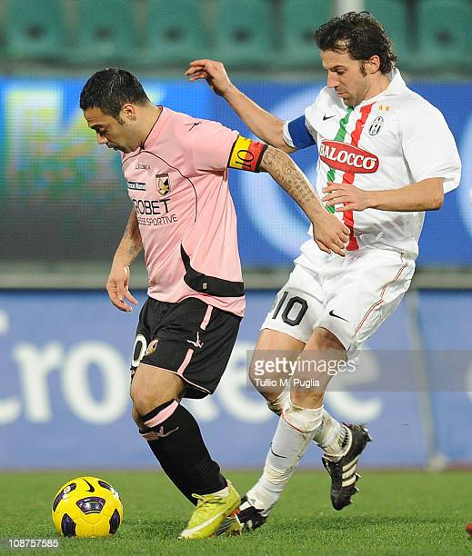 Fabrizio Miccoli of Palermo is challenged by Alessandro Del Piero of Juventus during the Serie A match between US Citta di Palermo and Juventus FC at...