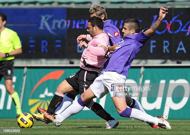 Fabrizio Miccoli of Palermo is challenged by Alessandro Gamberini and Valon Behrami of Fiorentina during the Serie A match between US Citta di...