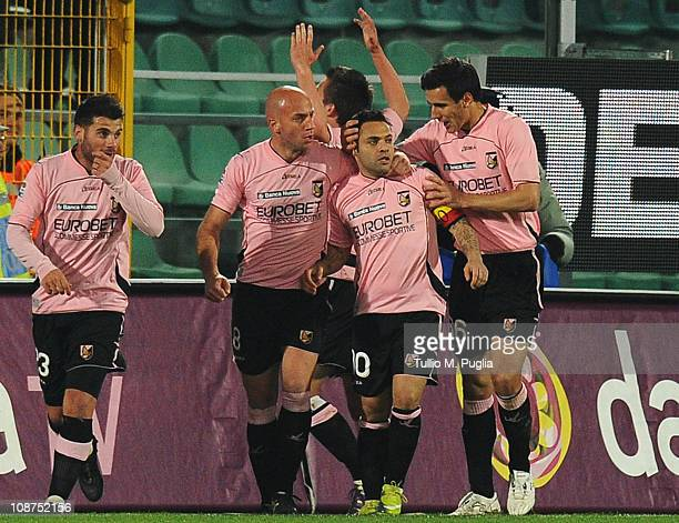 Fabrizio Miccoli of Palermo is congratulated by teammates after scoring the opening goal of the Serie A match between US Citta di Palermo and...