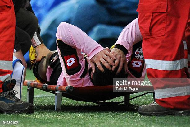 Fabrizio Miccoli of Palermo lies on a stretcher after sustaining an injury during the Serie A match between US Citta di Palermo and AC Siena at...