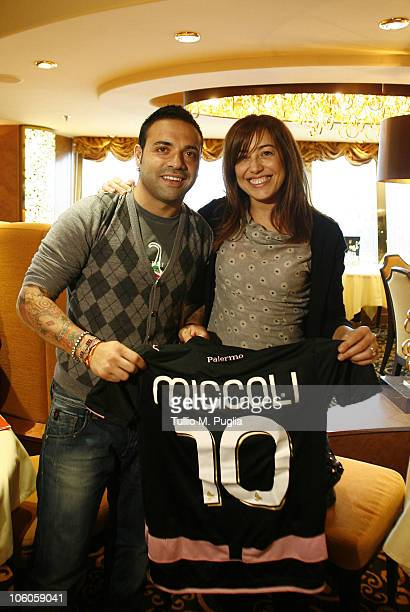 Fabrizio Miccoli of Palermo poses with a fan on the ship for the opening tournaments of the Mediterranean Cruise Eurobetpoker on October 26 2010 in...