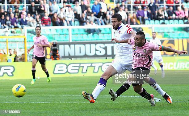 Fabrizio Miccoli of Palermo scores his team's opening goal during the Serie A match between US Citta di Palermo and ACF Fiorentina at Stadio Renzo...
