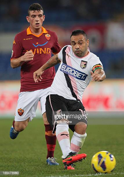 Fabrizio Miccoli of US Citta di Palermo competes for the ball with Alessandro Florenzi of AS Roma during the Serie A match between AS Roma and US...