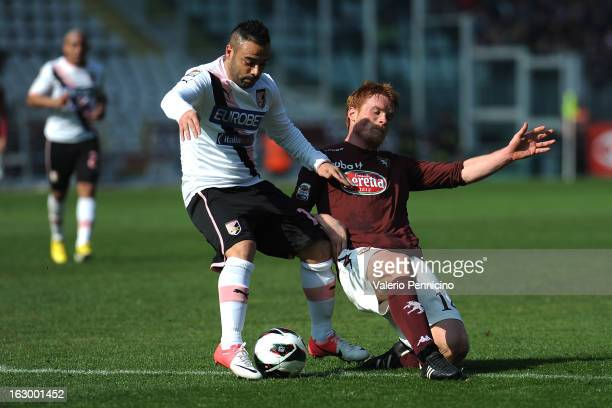 Fabrizio Miccoli of US Citta di Palermo is challenged by Alessandro Gazzi of Torino FC during the Serie A match between Torino FC and US Citta di...