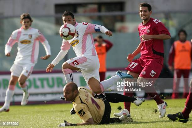 Fabrizio Miccoli of US Citta' di Palermo scores their fist goal during the Serie A match between AS Livorno Calcio and US Citta' di Palermo at Stadio...