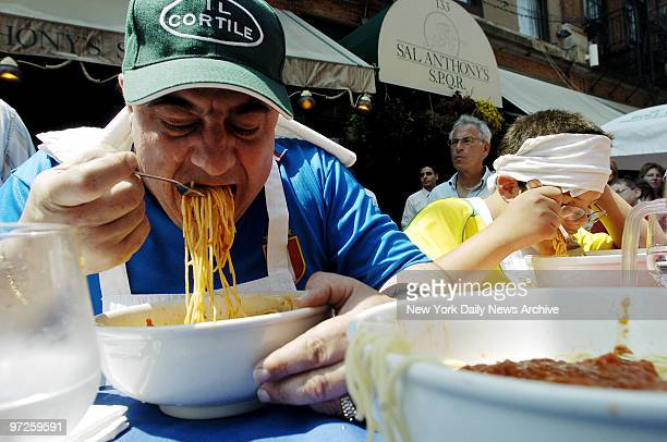 Fabrizio Rinaldi the defending champion gobbles his second bowl of pasta during the 4th annual Tuttorosso Pasta Eating Competition this afternoon...