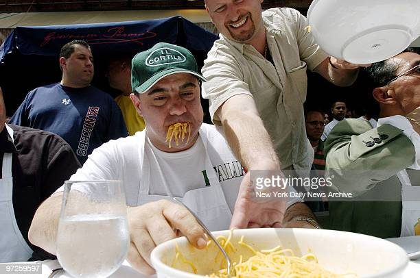 Fabrizio Rinaldi with spaghetti still hanging out of his mouth starts in on another bowl of pasta and marinara sauce during the Third Annual Little...