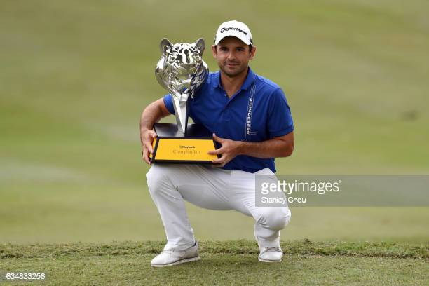 Fabrizio Zanotti of Paraguay celebrates with the Maybank Championship trophy after finishing 19 under for the tournament during Day Four of the...