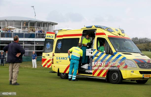 Fabrizio Zanotti of Paraguay is taken away by an ambulance after being struck with a ball by the tee shot from Alexandre Kaleka of France during Day...