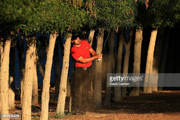 Fabrizio Zanotti of Paraguay plays his second shot on the par 5 10th hole during the second round of the 2015 Omega Dubai Desert Classic on the...