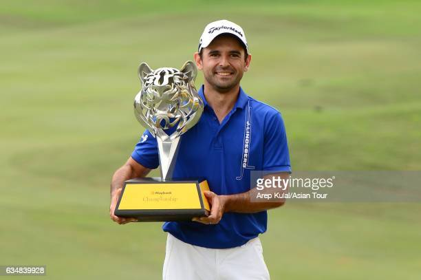 Fabrizio Zanotti of Paraguay pose with the trophy after winning the Maybank Championship Malaysia at Saujana Golf and Country Club on February 12...