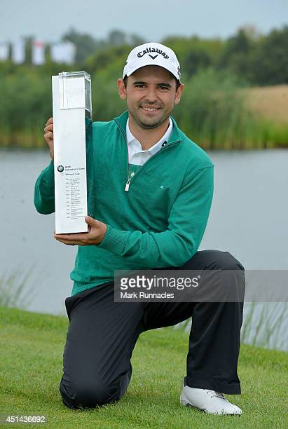 Fabrizio Zanotti of Paraguay winner of the BMW International Open at Golf Club Gut Larchenhof with the trophy on June 29 2014 in Cologne Germany