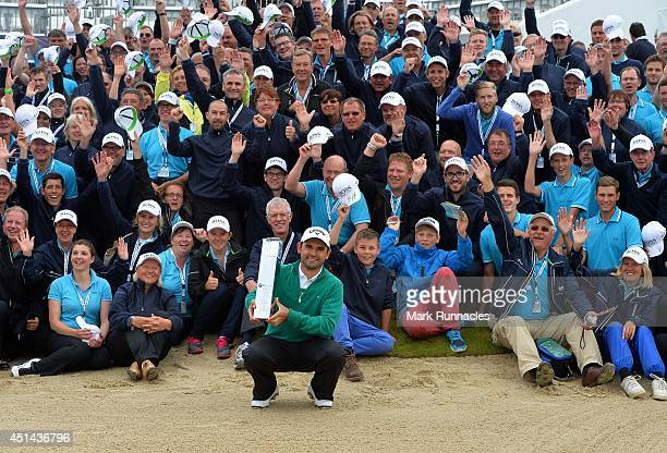 Fabrizio Zanotti of Paraguay winner of the BMW International Open at Golf Club Gut Larchenhof with the Marshals and the trophy on June 29 2014 in...