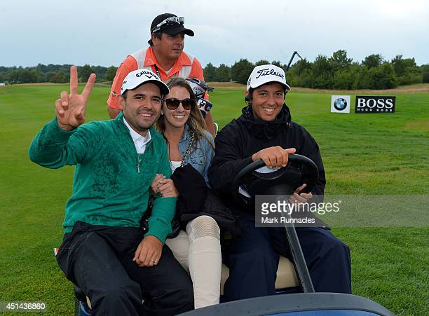 Fabrizio Zanotti of Paraguay winner of the BMW International Open at Golf Club Gut Larchenhof with this wife Luca and caddie Alejandro Molina is...