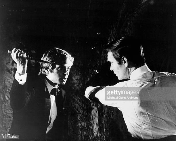 Fabrizzio Capucci attacks Louis Jourdan in a scene from the film 'To Commit a Murder' 1967