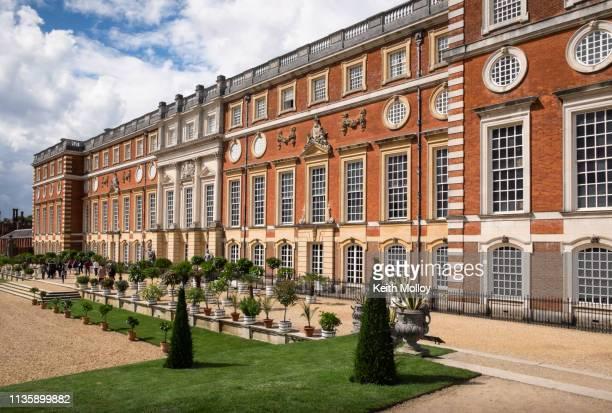 facade and gardens at hampton court palace. - hampton court stock pictures, royalty-free photos & images