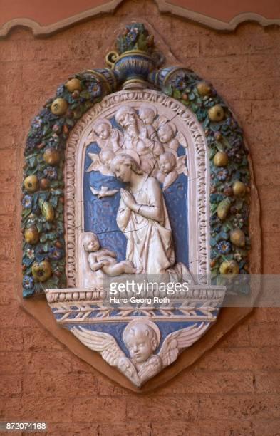 Facade ceramics with Virgin Mary and Jesus in Via Farini