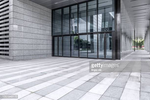 facade of a building in a business district in hangzhou, china - building entrance stock pictures, royalty-free photos & images