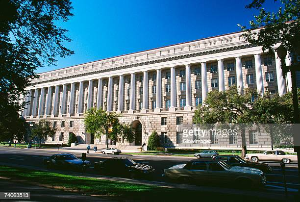 facade of a government building, internal revenue service building, washington dc, usa - irs stock photos and pictures