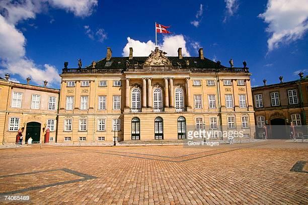 facade of a palace, amalienborg palace, copenhagen, denmark - amalienborg palace stock pictures, royalty-free photos & images