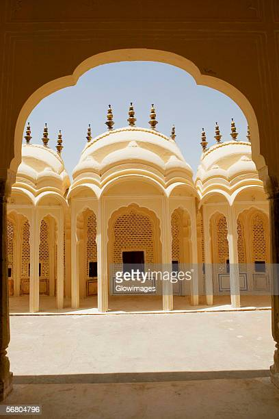 Facade of a palace seen through an arched corridor, City Palace, Jaipur, Rajasthan, India