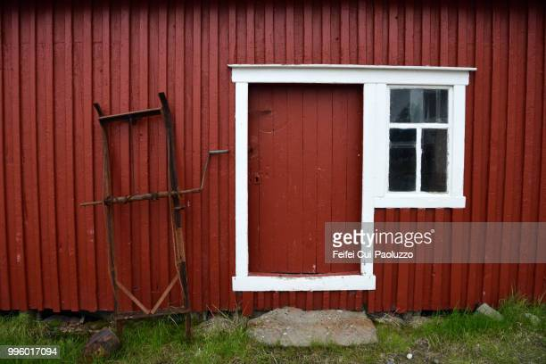 Facade of a red wooden building at Risøyhamn, Andøya Island, Norway