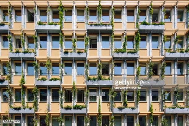 Facade of a residential building with vertical garden