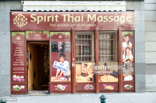 facade of a thai massage parlour in budapest during summer day - thai massage stock photos and pictures