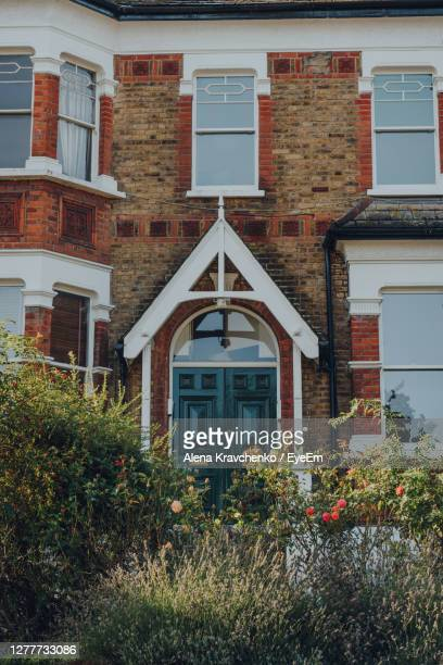facade of a traditional terraced house in crouch end, london, uk, view over the greenery. - district stock pictures, royalty-free photos & images