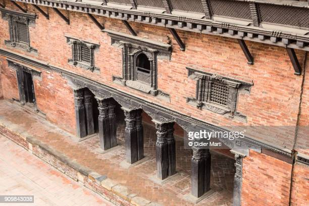 facade of an ancient traditional newar building in patan durbar square in nepal - nepal photos stock pictures, royalty-free photos & images