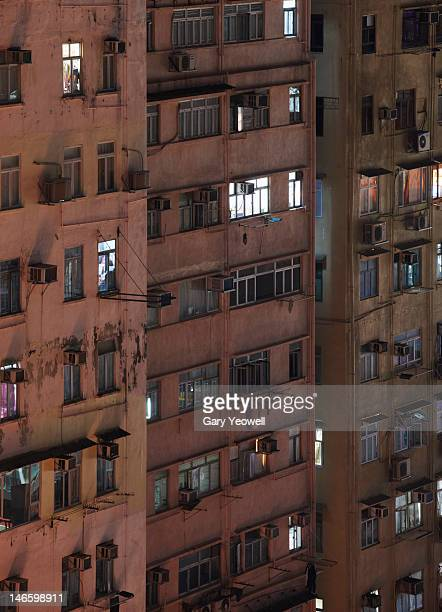 facade of apartment buildings at night - yeowell stock pictures, royalty-free photos & images