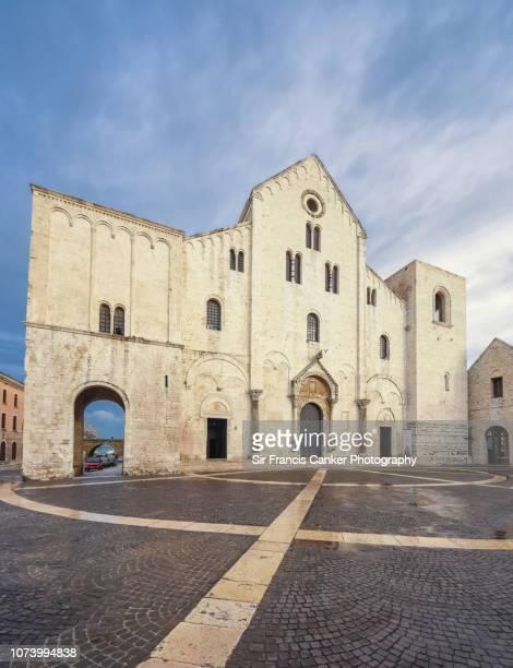 facade of basilica di san nicola in romanesque norman style in bari, apulia, italy - basilica di san nicola bari foto e immagini stock