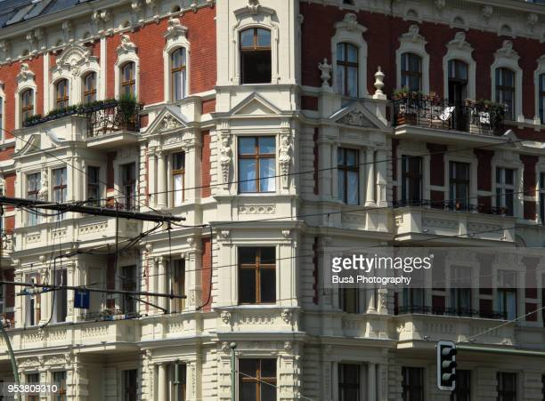 facade of beautifully renovated old building in the danziger strasse in berlin (germany), district of prenzlauerberg - prenzlauer berg stock photos and pictures