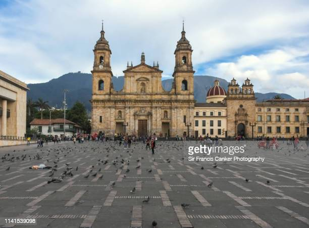 facade of bogota cathedral and capilla del sagrario on bolivar square (plaza bolivar) rightbeforesunset in bogota, colombia - bogota stock pictures, royalty-free photos & images