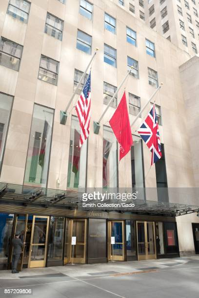 Facade of Christie's auction house with flags and doorman visible in Manhattan New York City New York September 15 2017