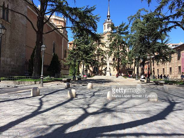 facade of church with bumpy obstacles - alcala de henares stock pictures, royalty-free photos & images