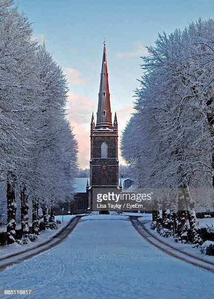 facade of church with snow covered trees during winter - hillsborough sheffield stock pictures, royalty-free photos & images