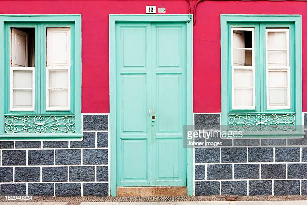 facade of colorful house - symmetry stock pictures, royalty-free photos & images