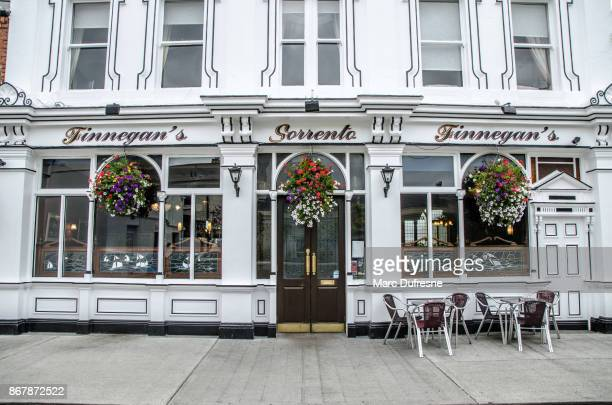 facade of finnegan's restaurant in dalkey ireland during day of autumn - dalkey stock pictures, royalty-free photos & images