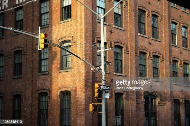 facade of former industrial building, now office space, along washington street, by the brooklyn bridge, in brooklyn, new york city - brooklyn new york stock pictures, royalty-free photos & images