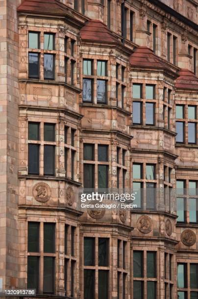 facade of historical building - carving craft product stock pictures, royalty-free photos & images