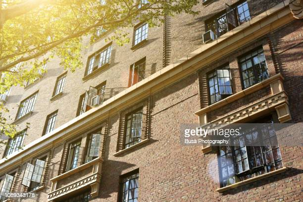 facade of large pre-war apartment building in fort greene, brooklyn, new york city - fort greene stock pictures, royalty-free photos & images