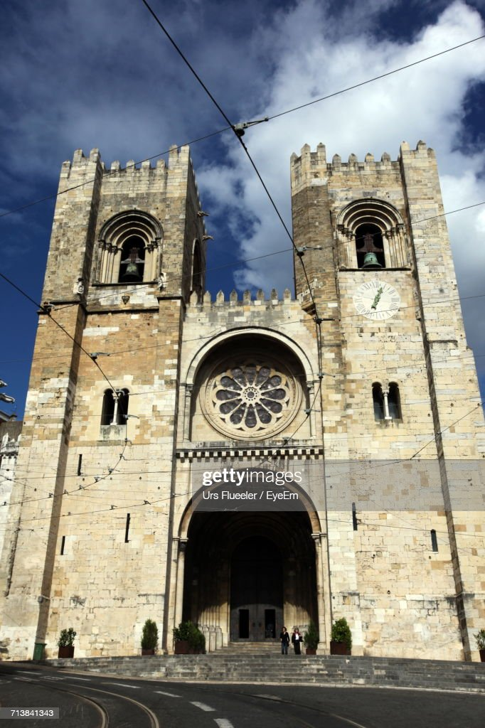 Facade Of Lisbon Cathedral Against Sky : Stock Photo