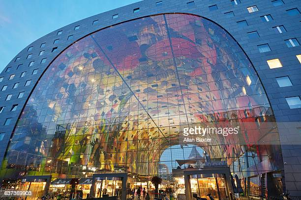 Facade of Markthal Market Hall at dusk