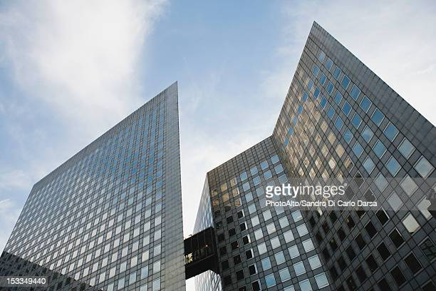 Facade of modern office buildings against sky, low angle view