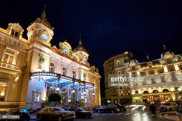 Facade of Monte Carlo casino illuminated at night