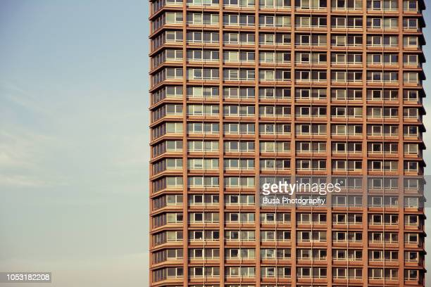 facade of office tower in milan, italy - ugly wallpaper stock photos and pictures