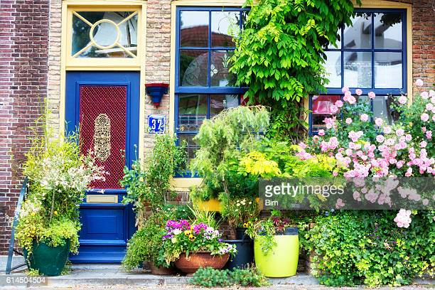 facade of old house decorated with flowers, brielle, netherlands, europe - facade stock pictures, royalty-free photos & images
